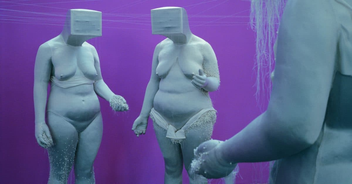 Naked female sculptures with boxes on their heads