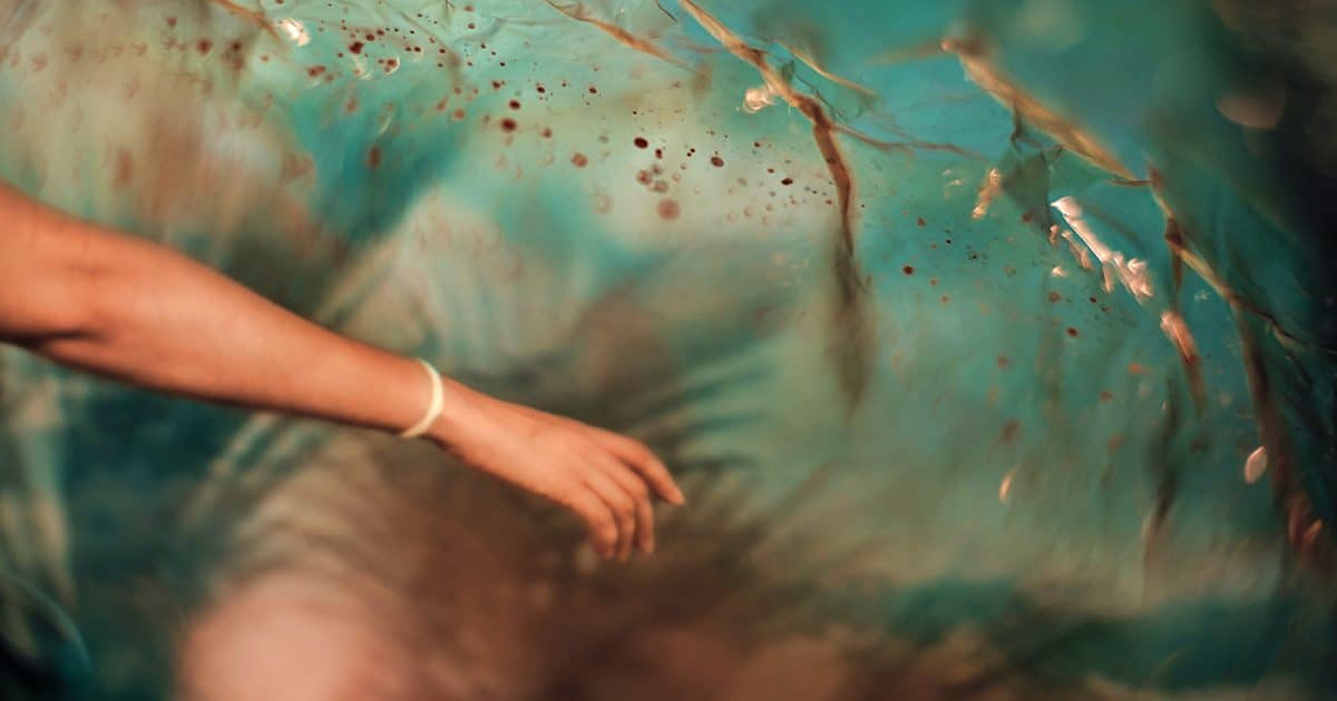DoubleBlind: An arm in front of a trippy background. In This Article, Doubleblind suggests if you cant go out go in. How Psychedelics make quarantine a time of self renewal