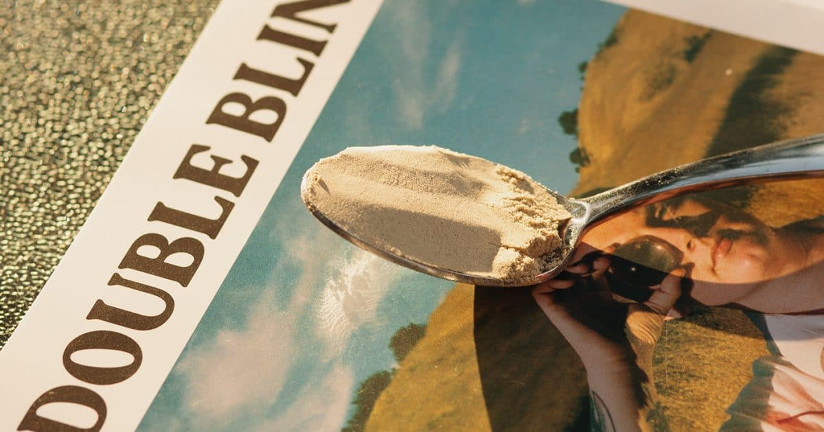 DoubleBlind: Spoon full of kava extract on copy of a DoubleBlind magazine.