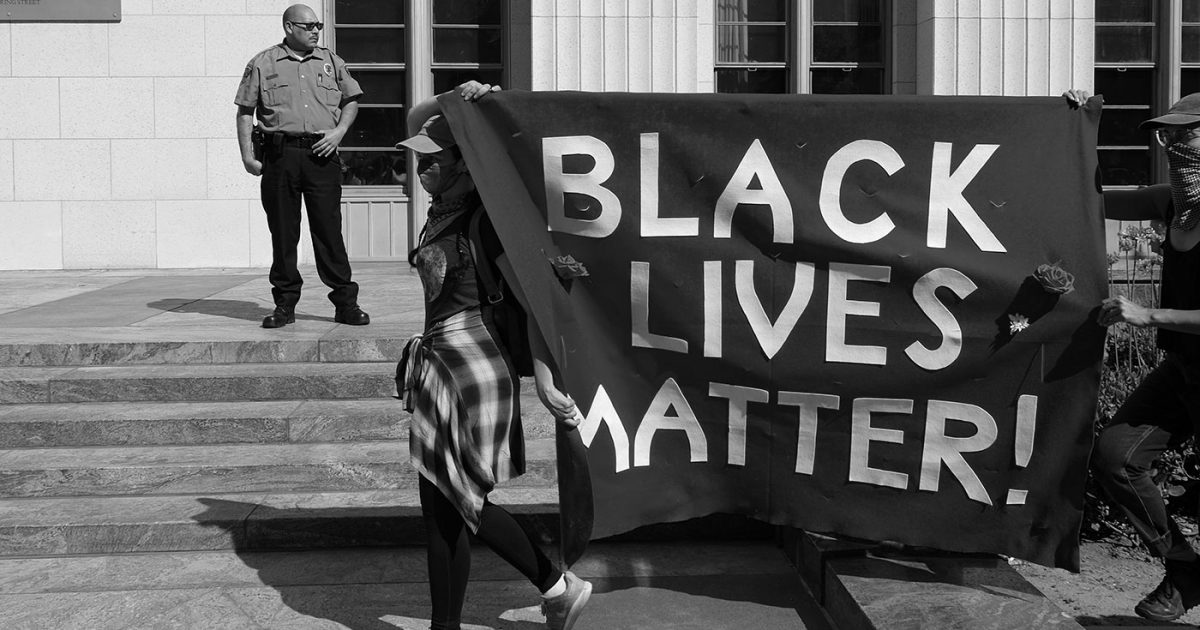 DoubleBlind: Protesters holding Black Lives Matter. In this article, DoubleBlind explores what the psychedelic industry can do to fight racial injustice.