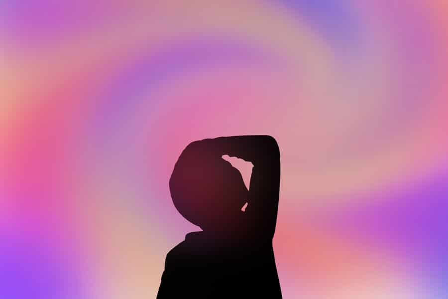 DoubleBlind: Illustration of person holding head on swirled background. In this article, DoubleBlind explores the long term risks and benefits of microdosing psychedelics.