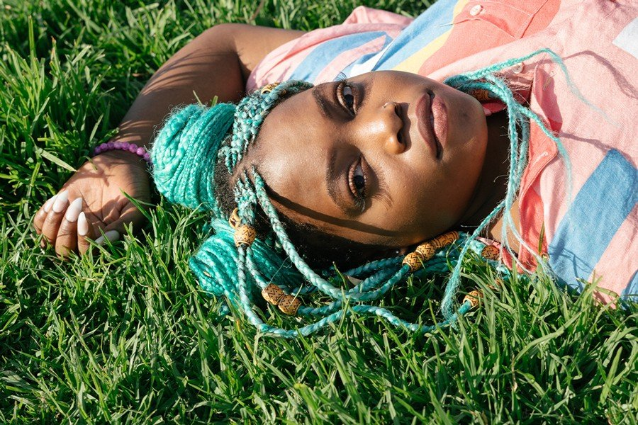 DoubleBlind: Image of woman laying in grass. In this article, DoubleBlind explores the importance of set and setting when using psychedelics.