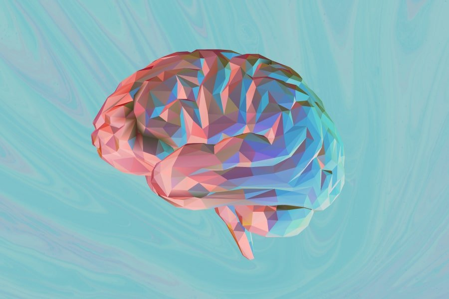 DoubleBlind: Image of blue and pink brain on blue swirly background. In this article, DoubleBlind explores the research surrounding endogenous DMT found in the brain.