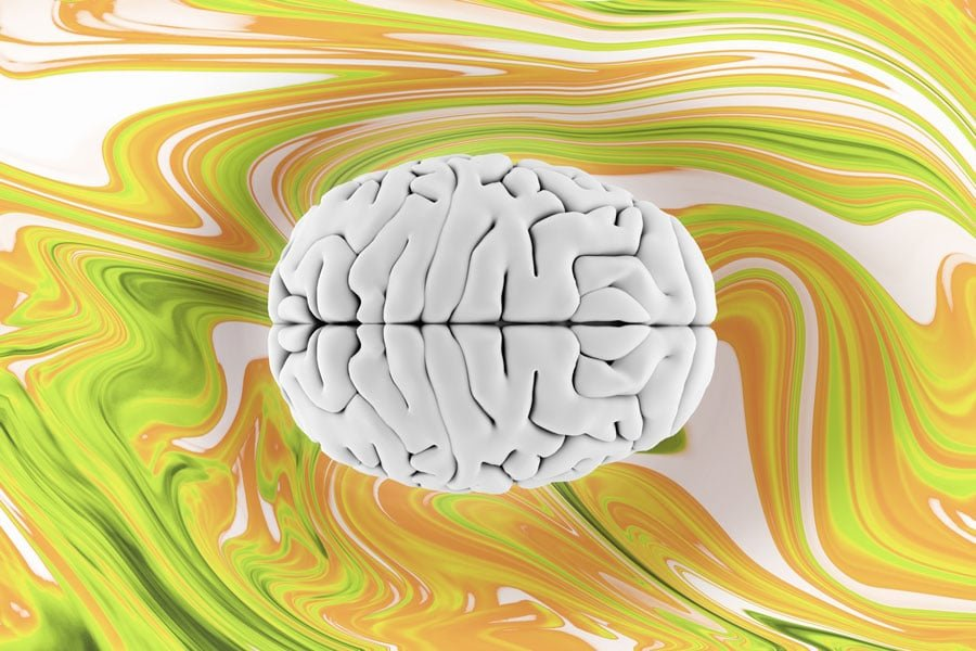 3D Image of brain on yellow and orange swirled background.