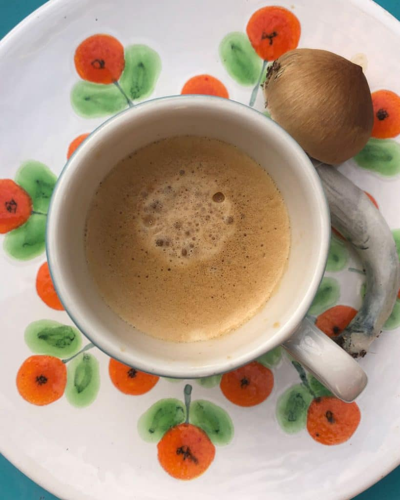 Image of magic mushrooms next to a cup of tea.