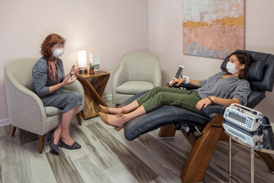Women talking in clinic