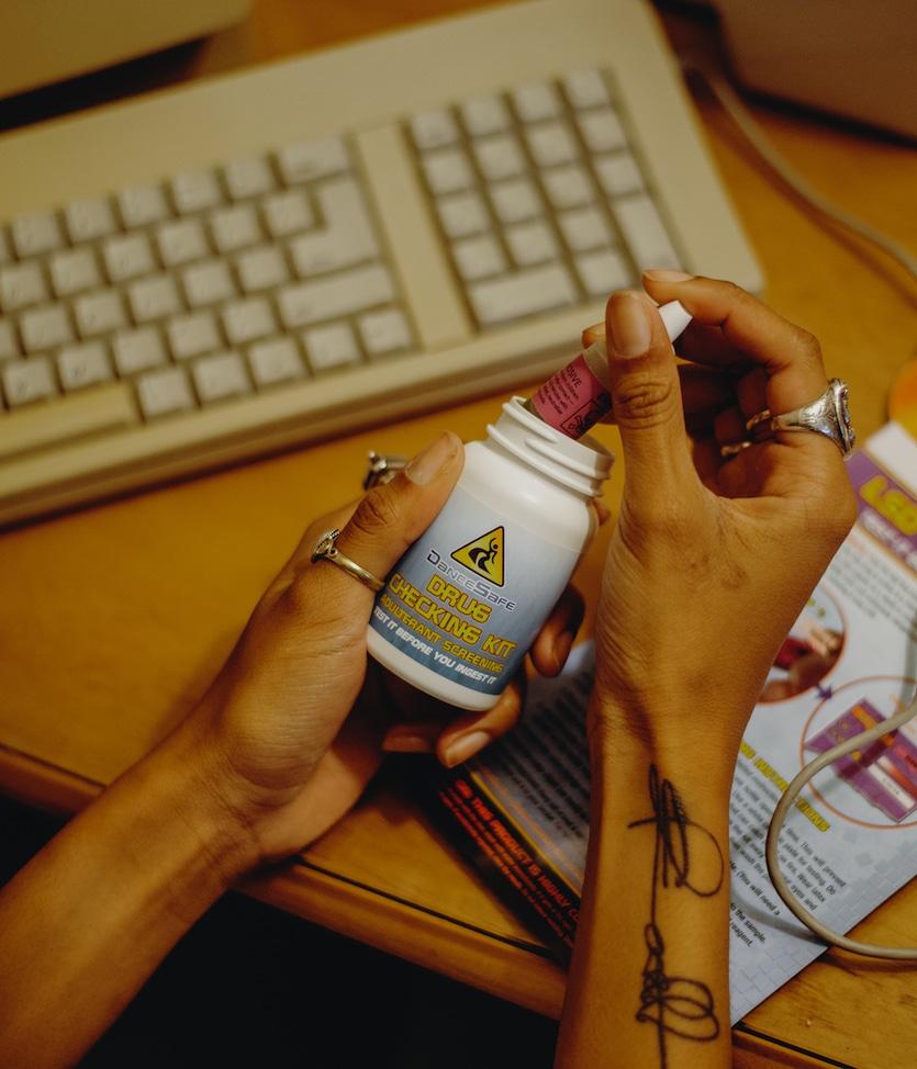 hands holding test kit bottle